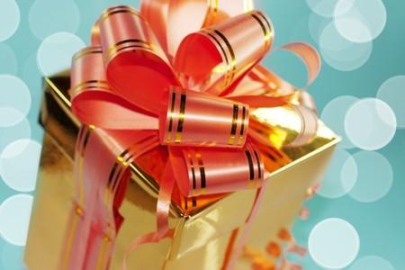 gold gift on blue holiday background photo