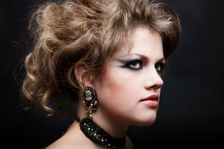 beautiful fashionable woman with fashionable hairstyle photo