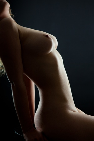 silhouette of beautiful womans body on black