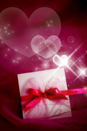 valentine card lying on the red satin Stock Photo - 8544474