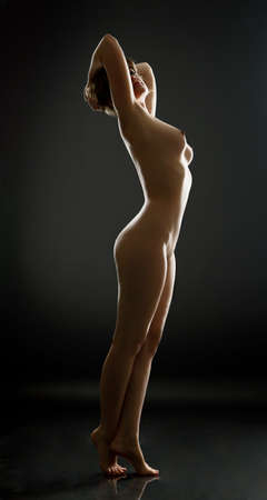 beautiful naked woman on black background
