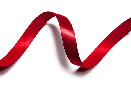 white silk: image of red ribbon on white background Stock Photo