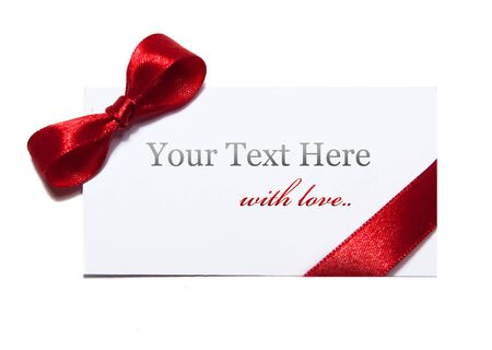cardboard with red satin ribbon on white