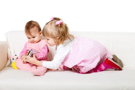 two adorable kids sitting on the sofa photo