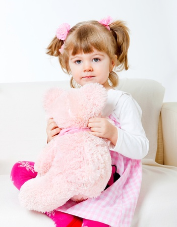 beautiful little girl with pink bear