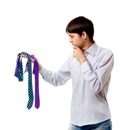 young person chooses to tie isolated on white background photo