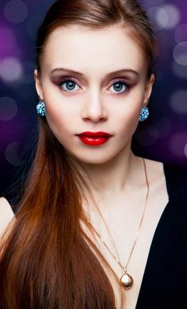 jewelry model: portrait of beautiful fashionable woman on dark background Stock Photo
