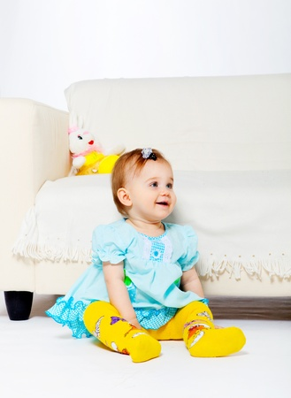 Sweet baby girl sitting on the floor Stock Photo - 9620907
