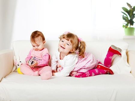 two adorable kids sitting on the sofa Stock Photo - 9620900