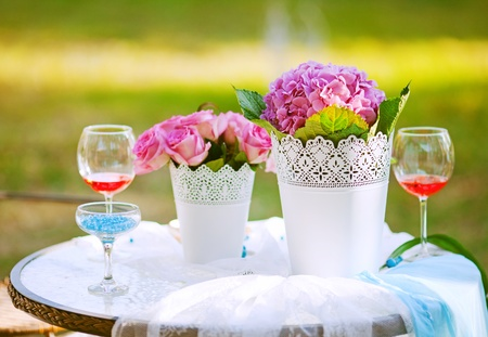 beautiful wedding table decorated with the flowers photo