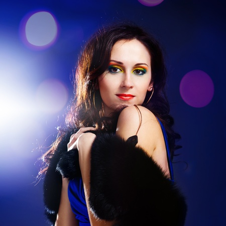 beautiful woman with bright make-up on black background photo