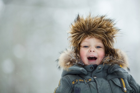 Closeup portrait of happy child in winter hat Stock Photo