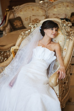 portrait of beautiful bride in luxury interior photo