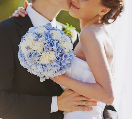 wedding couple with blue bouquet