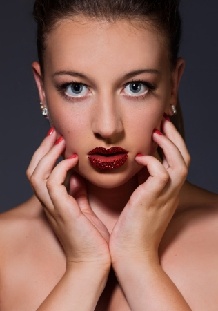 Close-up image of model with Swarovski crystals on the lips photo