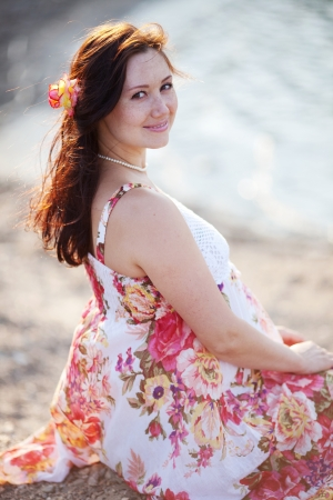 portrait of beautiful pregnant woman on the beach photo