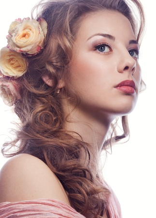 Portrait of beautiful girl with roses in the hair Stock Photo - 18748085