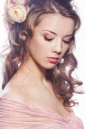 Portrait of beautiful girl with roses in the hair Stock Photo - 18748137