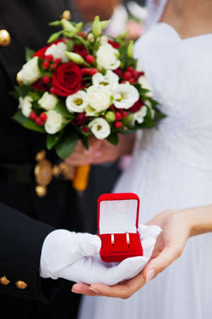 Wedding couple with rings in the hands photo