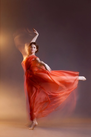 Portrait of beautiful dancing girl photo
