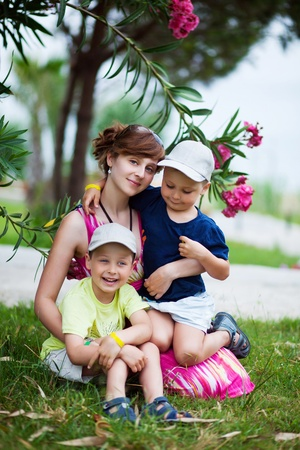 Mother with two her children in the park photo