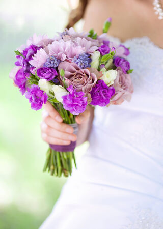 image of wedding bouquet in brides hand photo