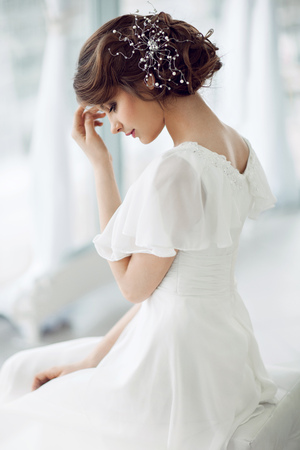 getting ready: Portrait of beautiful woman in white dress
