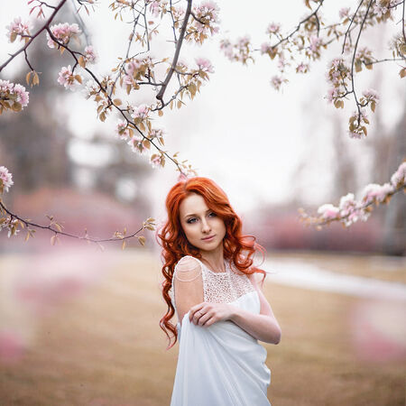red hair woman: Portrait of beautiful woman in white dress