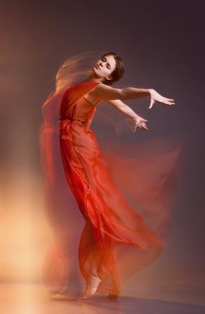 Portrait of beautiful dancing girl photo