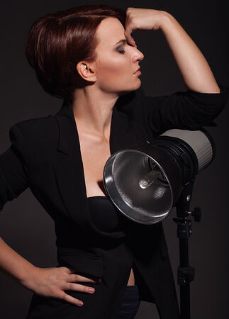 Beautiful woman with professional lighting on black background photo