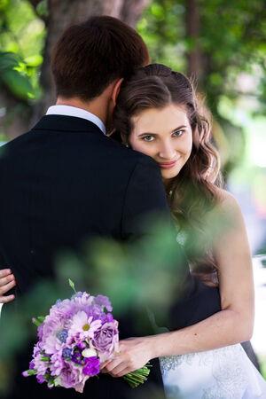 Portrait of wedding couple near the tree photo