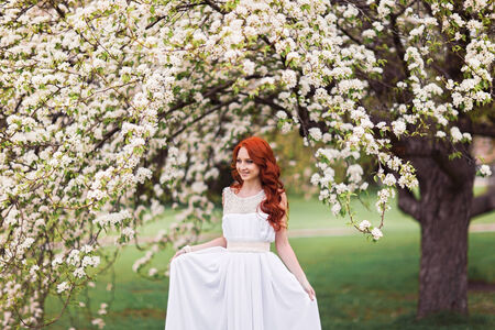 Portrait of beautiful woman in white dress photo