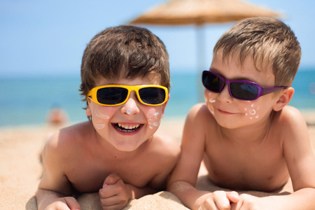 Close-up portrait of little boys on the beach Stock Photo