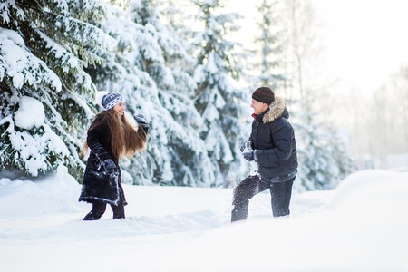 walk in: young couple have a walk in the winter park