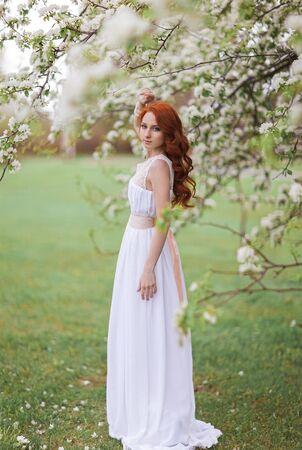 tender tenderness: Beautiful woman in the flowering park