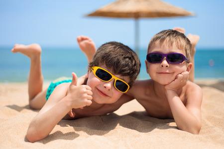 Close-up portrait of little boys on the beach photo