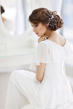 bride dress: Portrait of beautiful woman in girlish bedroom