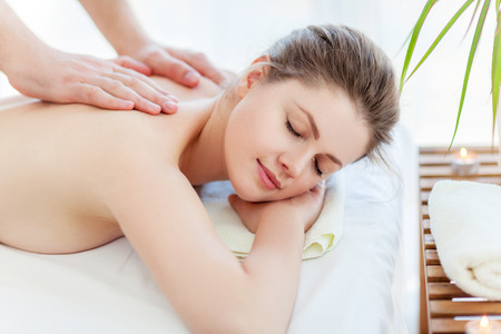 massage: Portrait of beautiful woman in massaging room Stock Photo