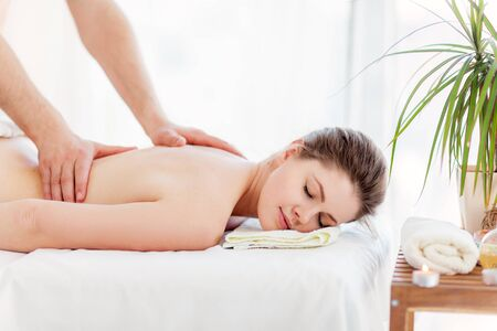 massagist: Portrait of beautiful woman in massaging room Stock Photo