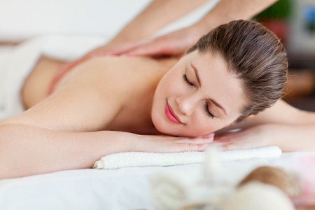 adult massage: Portrait of beautiful woman in massaging room Stock Photo