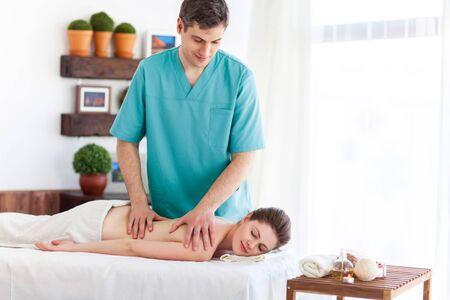 Portrait of beautiful woman in massaging room photo