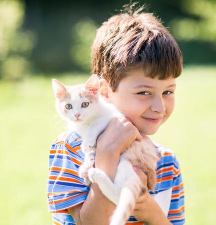 cute kittens: Portrait of child with kitten Stock Photo