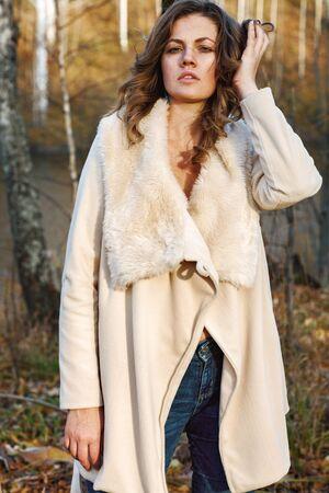 Portrait of fashionable woman in autumn park photo