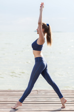 health and fitness: Full-length portrait of woman in fitness wear near the sea