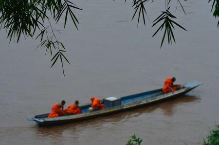 monks: Monks in a long boat