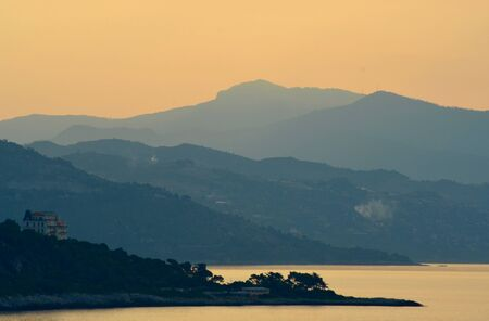 Sunrise over the hills of the Mediterranean. A white house is in the foreground Stock Photo