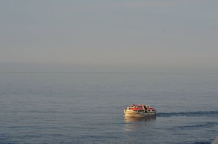A tender boat crusing on an empty sea. Stock Photo