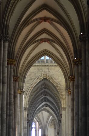 A series of gothic arches in a cathedral. They are built from grey and cream marble. Editorial