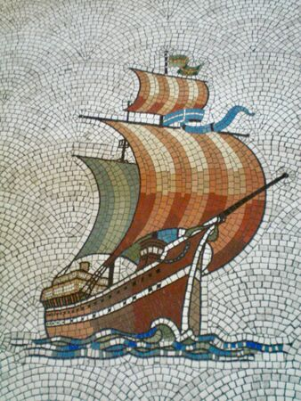 A mosaic of a galleon under sail. The background is of white tiles arranged in concentric arches.