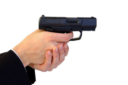 Holding pistol with two hands photo